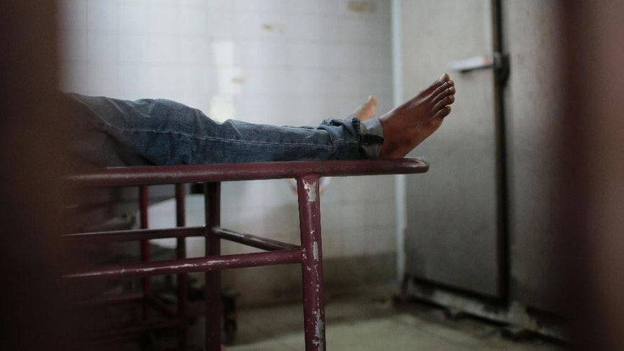 This Monday, March 30, 2015 photo shows the body of the late Bangladeshi blogger Qyasiqur Rahman Babu in a morgue at the Dhaka Medical College in Dhaka, Bangladesh. The blogger, 27, was hacked to death by three men in Bangladesh's capital on Monday, police said. The killing took place a month after a prominent Bangladeshi-American blogger known for speaking out against religious extremism was hacked to death in Dhaka. (AP Photo/A.M. Ahad)