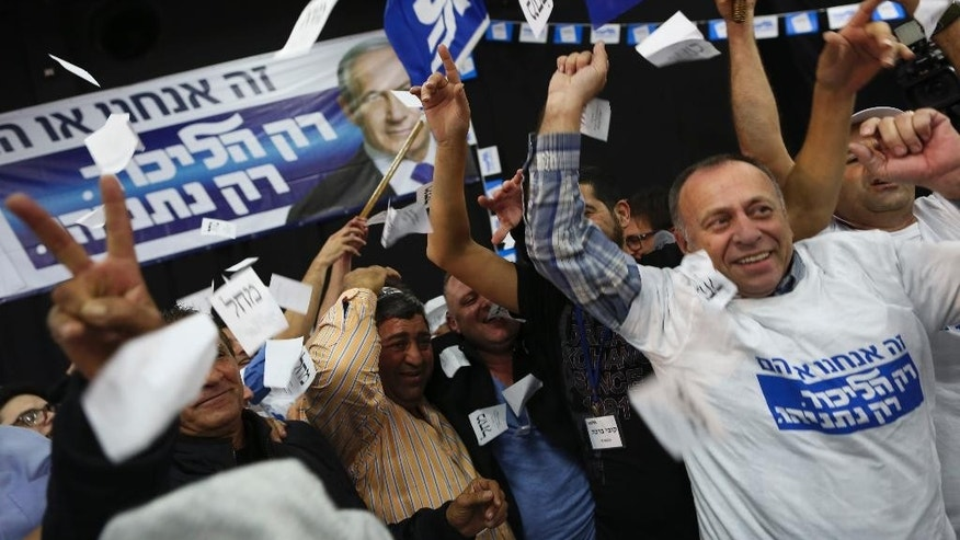 FILE - In this March 17, 2015 file photo, Israeli Prime Minister Benjamin Netanyahu Likud party supporters react to exit poll results at the party's election headquarters In Tel Aviv. Israel's visceral election campaign has exposed a rift that many here thought had long subsided the deep-seated schism between Jews of European and Middle Eastern descent. Mizrahi, or Middle Eastern, Jews heavily backed Prime Minister Benjamin Netanyahu's Likud Party, while Ashkenazi, or European, Jews mostly identified with the opposition Zionist Union. (AP Photo/Oded Balilty, File)