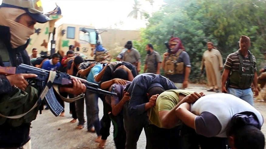 FILE - This file image posted on a militant website on Saturday, June 14, 2014, which has been verified and is consistent with other AP reporting, appears to show militants from the Islamic State group leading away captured Iraqi soldiers dressed in plain clothes after taking over a base in Tikrit. Iraq won the battle to retake the city of Tikrit from the Islamic State group, backed by a coalition of the unlikely in Iranian advisers, Shiite militias and U.S.-led airstrikes, but the country now faces what could be its most important battle: Winning the support of the Sunni.  (AP Photo via militant website, File)