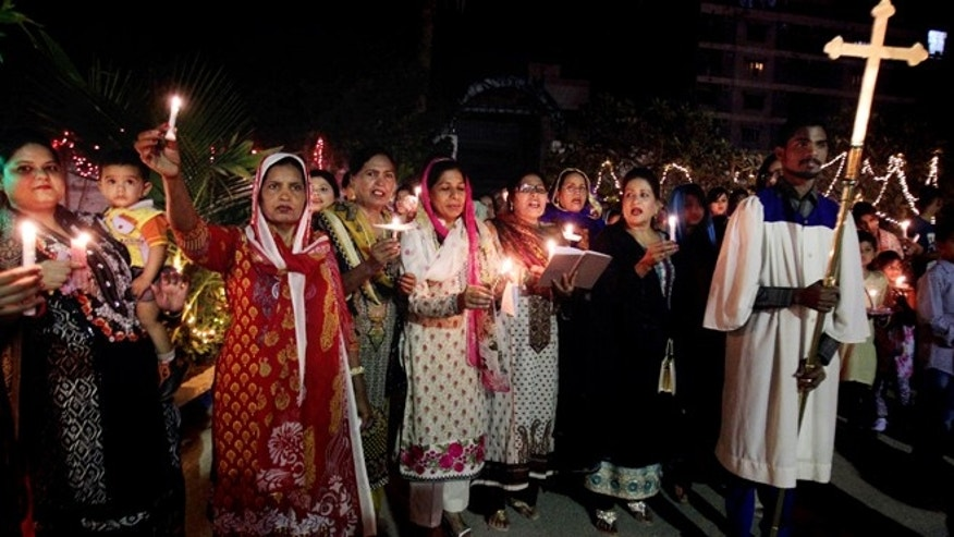 April 5, 2015: Pakistani Christians chant prayers during Easter service in Karachi, Pakistan.