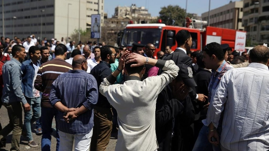 People gather at the scene of an explosion that killed at least one person on a bridge over the Nile River, near an upscale neighborhood of Cairo, Egypt, Sunday, April 5, 2015. Attacks mainly targeting Egyptian security forces have spiked since the 2013 military overthrow of Islamist President Mohammed Morsi following massive protests against his divisive rule. (AP Photo/Hassan Ammar)