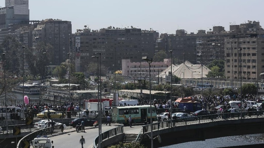 People gather at the scene of an explosion on a bridge over the Nile River near an upscale neighborhood killing at least one person in Cairo, Egypt, Sunday, April 5, 2015. Attacks mainly targeting Egyptian security forces have spiked since the 2013 military overthrow of Islamist President Mohammed Morsi following massive protests against his divisive rule.  (AP Photo/Nariman El-Mofty)