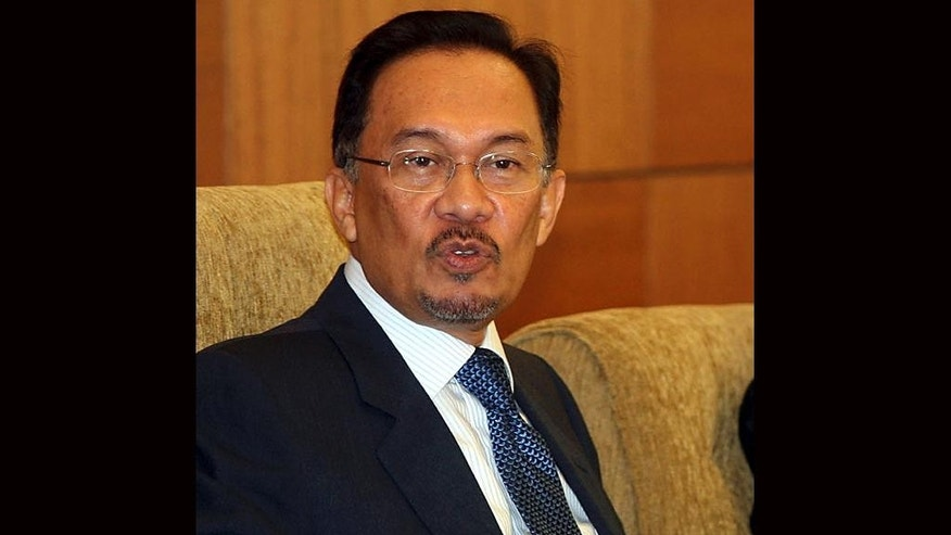 FILE - Malaysian opposition leader Anwar Ibrahim speaks during a news conference at Parliament House in Kuala Lumpur, Malaysia, in this Oct. 23, 2008 file photo. Ibrahim was granted a furlough Sunday April 5, 2015 to attend his father's funeral, soon after he began a five-year prison sentence on sodomy charges that he says are politically motivated.  (AP Photo/File)
