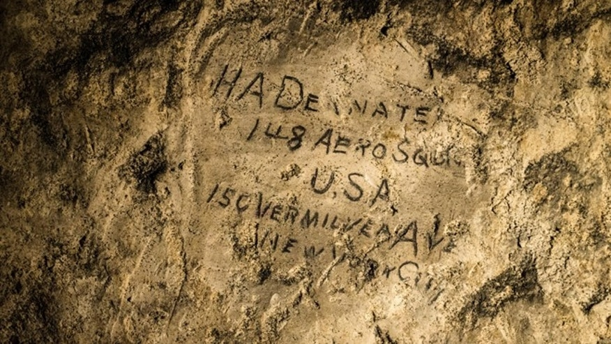 Feb. 20, 2015: A name engraved on the walls of a former chalk quarry, at the Cite Souterraine, Underground City, in Naours, northern France by HA Deanate, 148th Aero Squadron, USA.