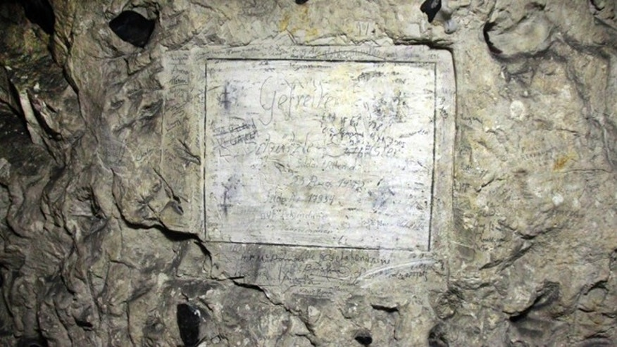 Feb. 20, 2015:  Names are engraved in a former chalk quarry, at the Cite Souterraine, Underground City, in Naours, northern France.