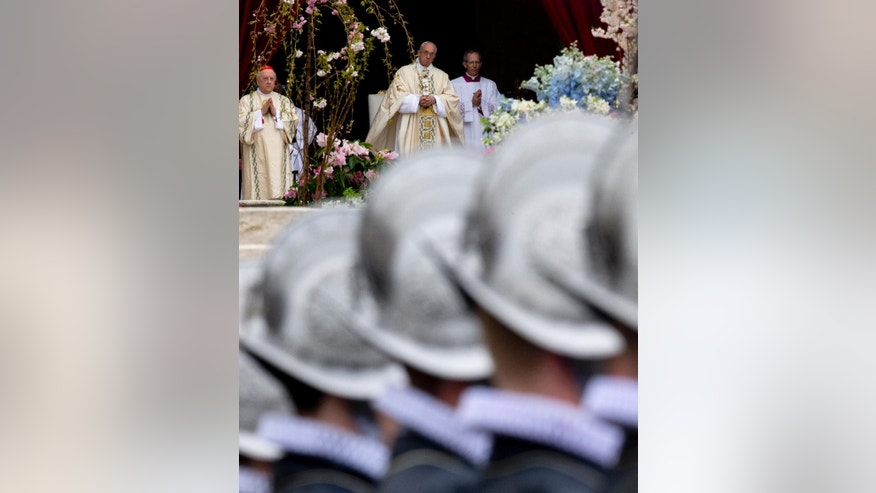 Pope Francis is framed by Swiss Guards as he celebrates an Easter mass, in St. Peter's square at the Vatican, Sunday, April 5, 2015. (AP Photo/Andrew Medichini)