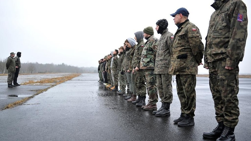 March 11, 2015 - Members of paramilitary National Guard muster near Szczecin, Poland, as they ready to counter threats and contain crisis situations in their area. Across many eastern European nations, ordinary people are heeding a call to receive military training in case of war, backed by NATO forces on a mission to reassure citizens  they're safe from Russian aggression.