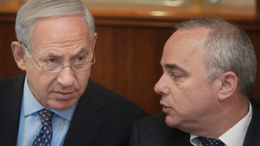 FILE - In this Monday, July 30, 2012 file photo, Israeli Prime Minister Benjamin Netanyahu, left, sits together with Finance Minister Yuval Steinitz, as they attend the weekly cabinet meeting in his Jerusalem office. Steinitz on Monday said taking military action against Iran's nuclear program is still an option, despite last week's framework deal between world powers and the Islamic Republic. (AP Photo/Sebastian Scheiner, File)