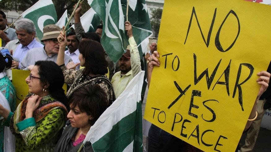 Members of Pakistan's civil society chant slogans against the Saudi-led coalition targeting Shiite rebels in Yemen, during a demonstration, in Lahore, Pakistan, Monday, April 6, 2015. A Saudi-led coalition targeting Shiite rebels in Yemen has asked Pakistan to contribute soldiers, Pakistan's defense minister said Monday, raising the possibility of a ground offensive in the country. (AP Photo/K.M. Chaudary)