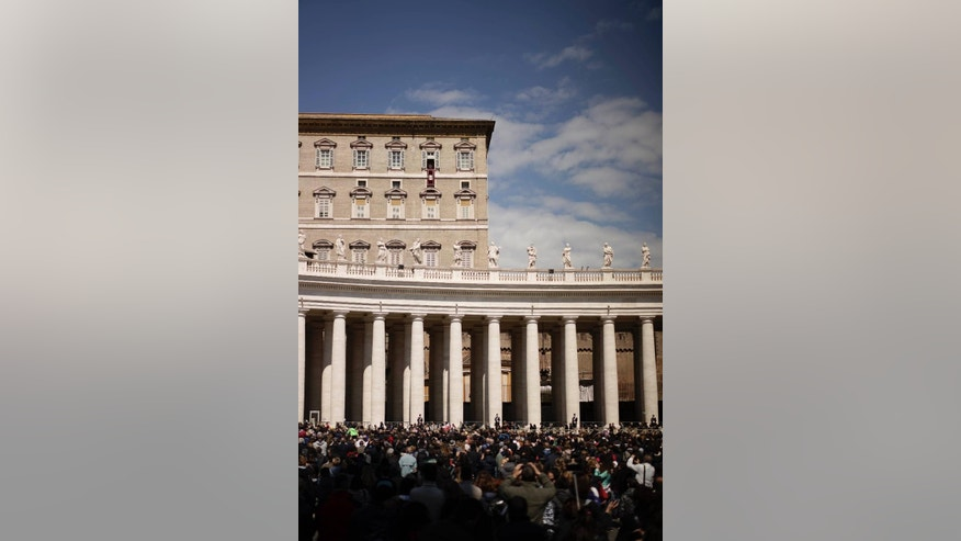 People crowd St. Peter's Square, at the Vatican, as Pope Francis celebrates the Regina Coeli Easter Monday prayer from the window of his studio,  Monday, April 6, 2015. (AP Photo/Andrew Medichini)