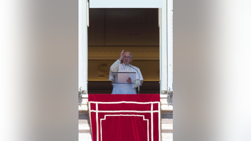 Pope Francis blesses the faithful as he celebrates the Regina Coeli Easter Monday prayer, from the window of his studio overlooking St. Peter's Square, at the Vatican,  Monday, April 6, 2015. (AP Photo/Andrew Medichini)