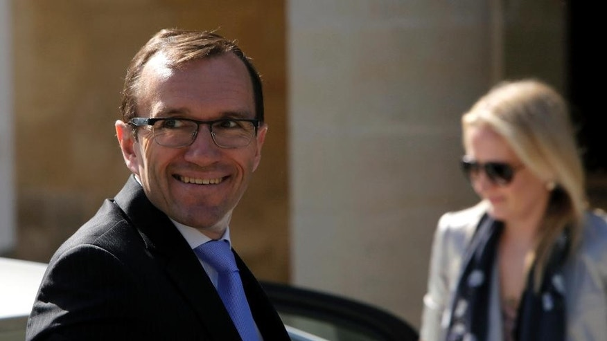 United Nations envoy for Cyprus, Norway's Espen Barth Eide arrives at the Presidential Palace for a meeting with Cyprus' President Nicos Anastasiades in divided capital Nicosia, Tuesday, April 7, 2015. Eide said halted talks on reunifying ethnically divided Cyprus will resume after a clash over the island's potential offshore gas riches has subsided. (AP Photo/Petros Karadjias)