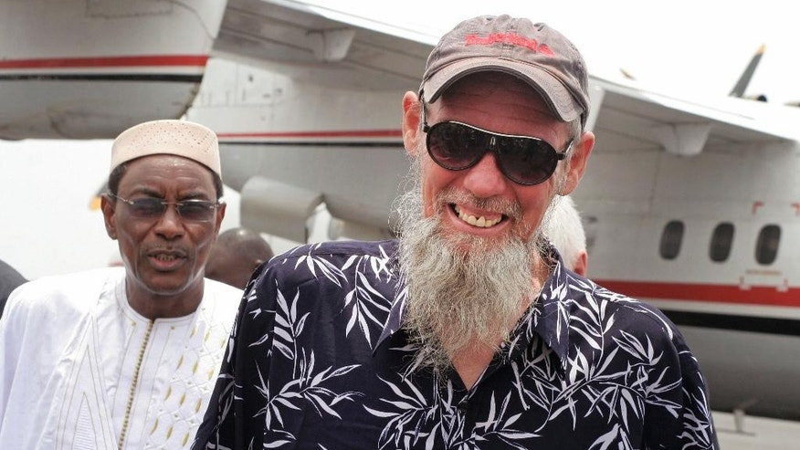Released Dutch hostage Sjaak Rijke smiles after arriving by airplane in Bamako, Mali, Tuesday, April 7, 2015. French special forces on Monday freed a Dutchman held hostage since being kidnapped in 2011 by extremists in Mali, the government said. There was no word on the fate of two men abducted at the same time. (AP Photo/Harouna Traore)