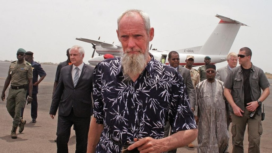 Released Dutch hostage Sjaak Rijke walks on the runway after arriving by airplane in Bamako, Mali, Tuesday, April 7, 2015. French special forces on Monday freed a Dutchman held hostage since being kidnapped in 2011 by extremists in Mali, the government said. There was no word on the fate of two men abducted at the same time. (AP Photo/Harouna Traore)