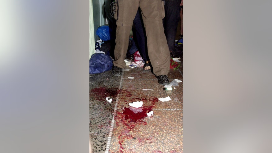 In this July 21, 2001file photo, pools of blood on the floor of the Diaz school in Genoa, Italy, used as headquarters by antigloblal activists, are seen after police searched through the building during the G8 summit.  Europe's top human rights court said Tuesday, April 7, 2015, the unpunished police beating of 62-year-old Arnaldo Cestaro during July 2001 protests at the Genoa G-8 summit amounted to torture. The night of July 21-22, 2001, both Cestaro and a group of protesters were in a school when police stormed the building. The court said Cestaro raised his arms in surrender, but was beaten and kicked by the officers, suffering fractures and other injuries. (AP Photo/Luca Bruno/file)