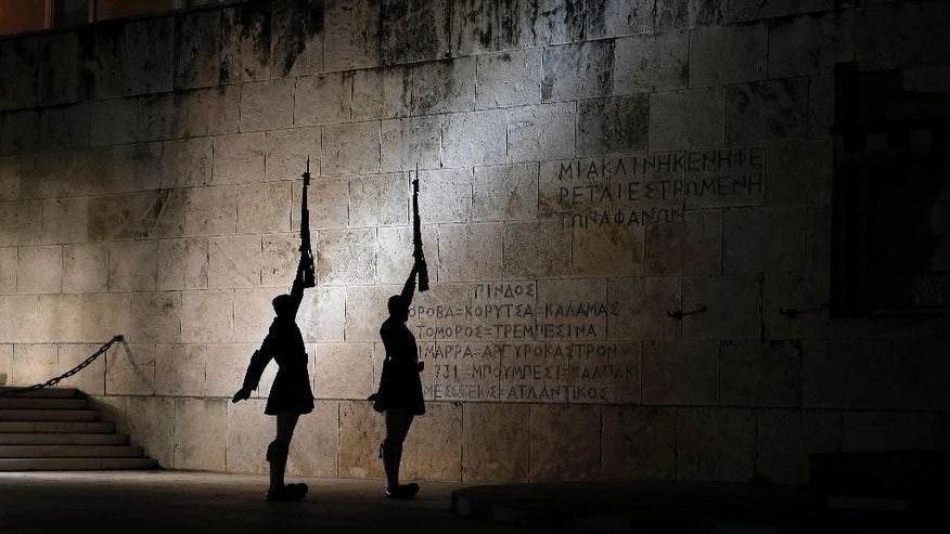 Presidential guards perform during a changing of the guard ceremony, at the tomb of the unknown soldier, in front of the Greek parliament in central Athens, Monday, April 6, 2015. Greece and its international creditors are still struggling to agree on a list of economic reforms that are deemed necessary for the country to unlock emergency funds and stay afloat. (AP Photo/ Petros Giannakouris)