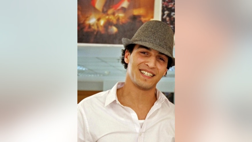 "In this May 2011 file photo, photojournalist Mahmoud Abu Zied, known as ""Shawkan,"" poses for a photograph during his graduation photo exhibit at Akhbar el Youm Academy in Cairo, Egypt. Shawkan was arrested in August 2013 while taking photographs of the government's violent dispersal of a sit-in by supporters of ousted Islamist President Mohammed Morsi. Shawkan who has spent over 600 days locked up without any charges describes his prison as a ""cemetery"" and his indefinite detention as ""psychologically unbearable"" in a letter published by a rights group. (AP Photo/Randa Shaath, File)"