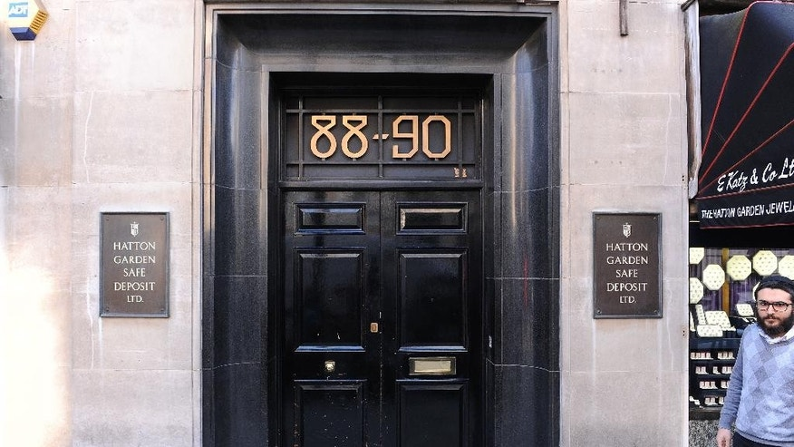 A general view of the Hatton Garden Safe Deposit company in London Tuesday May 7, 2015 after it was burgled over the weekend.  London police say heavy cutting equipment has been used to break into a vault at the Hatton Garden Safe Deposit company containing safety deposit boxes in the Hatton Garden jewelry district. Police said Tuesday that a number of safe deposit boxes were broken into. (AP Photo/Dominic Lipinski/PA) UNITED KINGDOM OUT