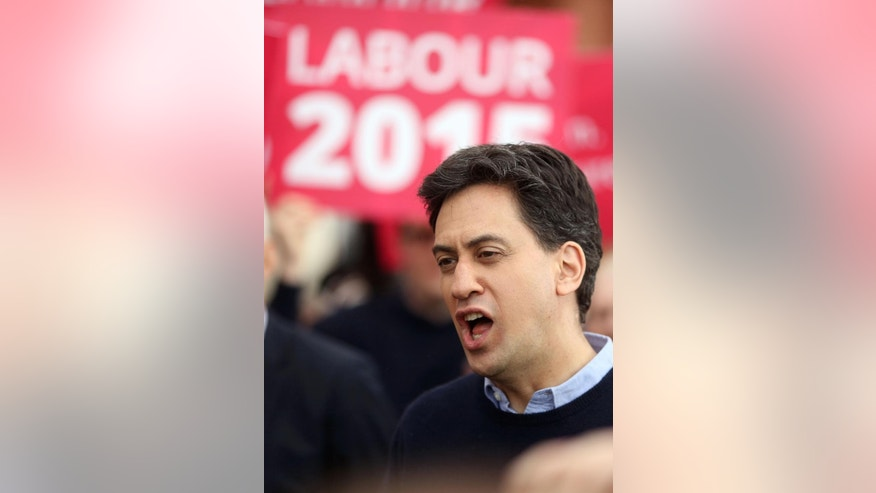 In this April 3, 2015 photo, Britain's Labour party leader Ed Miliband arrives in Blackpool, England, to meet Labour supporters while on the election campaign. Miliband's crusade to bring the Labour Party back to power after five years in opposition has struck a roadblock in Scotland, where the party is experiencing a dramatic drop in what had long been a reliable stronghold.  In the aftermath of a spirited referendum on independence last fall, Scotland is moving away from its traditional Labour Party voting habits in favor of the Scottish National Party, which favors splitting off from the rest of Britain. (AP Photo/PA, Chris Radburn) UNITED KINGDOM OUT; NO SALES; NO ARCHIVE
