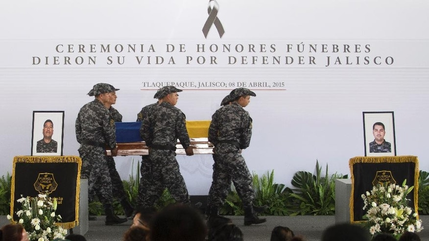Officers carry a coffin with the body of a slain police officer during a ceremony in Tlaquepaque, Mexico, Wednesday, April 8, 2015. On Monday, the Jalisco New Generation drug cartel stopped a police convoy on a rural highway and opened fire, killing 15 officers and wounding five in the bloodiest single attack on Mexican law enforcement in recent memory. (AP Photo/Refugio Ruiz)
