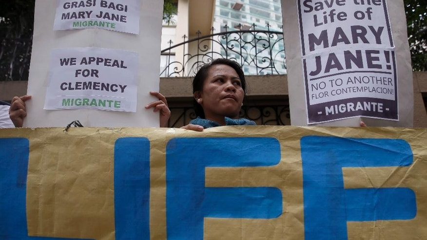 Supporters display placards outside the Indonesian Embassy at the financial district of Makati city, east of Manila, Philippines during a picket Wednesday, April 8, 2015 to ask for clemency for convicted drug trafficker Mary Jane Fiesta Veloso. Mary Jane Fiesta Veloso was convicted for drug trafficking in Indonesia and is sentenced to be executed after her appeal was rejected by the Indonesian Supreme Court March 26. (AP Photo/Bullit Marquez)