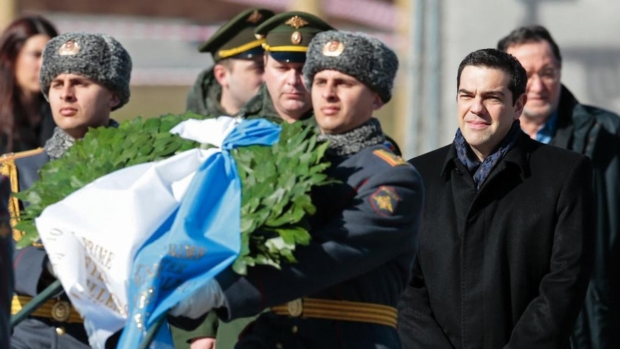 Greek Prime Minister Alexis Tsipras, second right, takes part in a wreath laying ceremony at the Tomb of the Unknown Soldier in Moscow, Russia, Wednesday, April 8, 2015. Tsipras is in Russia on an official visit. (AP Photo/Ivan Sekretarev, Pool)