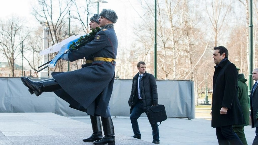 Greek Prime Minister Alexis Tsipras, foreground right, takes part in a wreath laying ceremony at the Tomb of the Unknown Soldier in Moscow, Russia, Wednesday, April 8, 2015. Tsipras is on an official visit to Russia. (AP Photo/ Ivan Sekretarev, Pool)