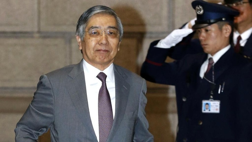 Bank of Japan Gov. Haruhiko Kuroda, left, arrives for a meeting at the BOJ's head office in Tokyo, Wednesday, April 8, 2015. Two years after launching a bazooka of ultra-lavish monetary easing, Bank of Japan Gov. Kuroda has made only fitful progress toward the goal of the 2 percent inflation rate he and Prime Minister Shinzo Abe said was needed to jolt the world's No. 3 economy out of its deflationary rut. (AP Photo/Kyodo News) JAPAN OUT, MANDATORY CREDIT