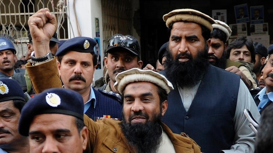 FILE - In this Thursday, Jan. 1, 2015 file photo, Zaki-ur-Rahman Lakhvi, the main suspect of the Mumbai terror attacks in 2008, raises his fist after his court appearance in Islamabad, Pakistan. A defense lawyer said Thursday, April 9, 2015 that a Pakistani court has ordered the release of the main suspect in the 2008 Mumbai attacks for the second time in less than a month.(AP Photo/B.K. Bangash, File)