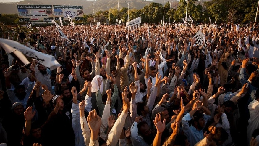 Supporters of Pakistani religious group Jamat ud Dawa raise their hands during a rally to support the Saudi Arabian government, in Islamabad, Pakistan, Thursday, April 9, 2015. A joint session of the Parliament is in progress to discuss the Yemen situation and debate whether to join the Saudi-led coalition against anti-government rebels in Yemen. (AP Photo/B.K. Bangash)