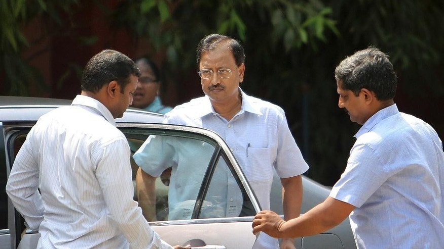 Satyam Computer Services founder B. Rama Raju, centre, arrives at a court in Hyderabad, India, Thursday, April 9, 2015. An Indian court on Thursday convicted Raju, the founder of the outsourcing giant and nine others on charges of stealing millions of dollars in one of the largest frauds in the country's corporate history. (AP Photo/Mahesh Kumar A.)