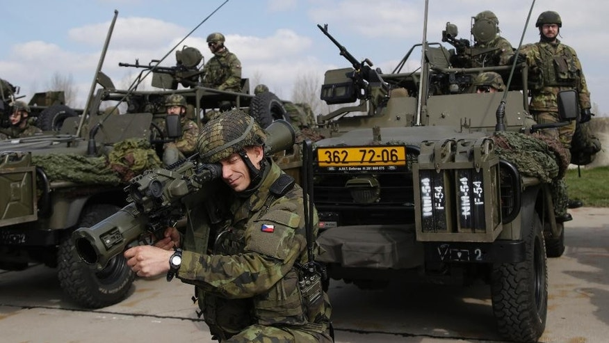 "Czech Republic's soldiers from the 43rd airborne battalion take part in the NATO drill ""The Noble Jump"" at the airport in Pardubice, Czech Republic, Thursday, April 9, 2015. NATO is completing an initial exercise and first testing of its new rapid response force that has been created to face new challenges from Russia. (AP Photo/Petr David Josek)"
