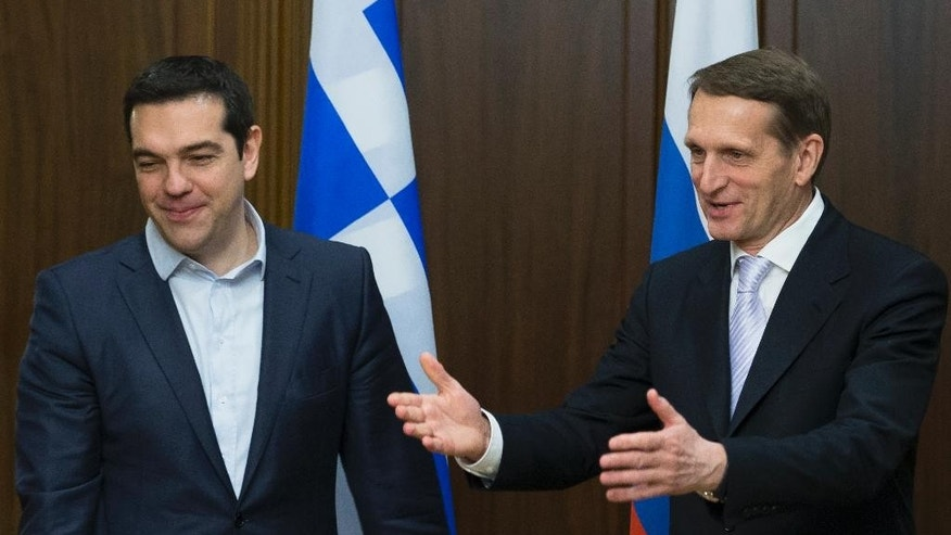 Sergei Naryshkin, right, speaker of the State Duma, lower parliament chamber, right, welcomes Greek Prime Minister Alexis Tsipras in Moscow, Russia, Thursday, April 9, 2015. Greece's international creditors are watching Tsipras' visit to Russia with concern amid speculation that Greece might seek aid from Russia, as a bargaining chip with Western creditors.  (AP Photo/Ivan Sekretarev)