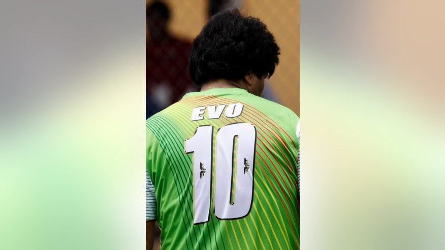 "Bolivia's President Evo Morales wears a soccer jersey that identifies him by his first name and the #10, during a friendly soccer match with delegations from the ""People's Summit,"" in Panama City, Friday, April 10, 2015. Morales is in Panama to attend the VII Summit of the Americas. (AP Photo/Arnulfo Franco)"