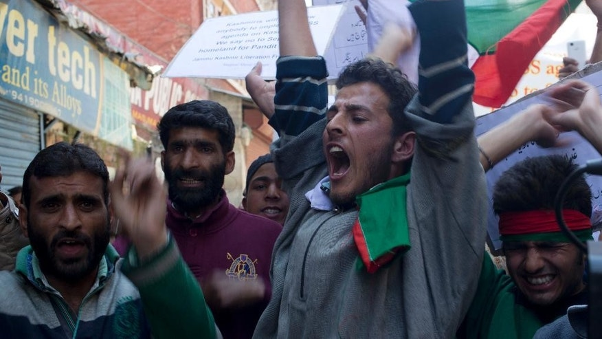 Supporters of Jammu and Kashmir Liberation Front (JKLF) shout slogans against India during a protest march in Srinagar, Indian controlled Kashmir, Friday, April 10, 2015. Protests and clashes erupted Friday against government plan to build townships for displaced Kashmiri Hindus who fled the Muslim-majority areas of the disputed Himalayan region with the onset of armed rebellion against Indian rule. (AP Photo/Dar Yasin)