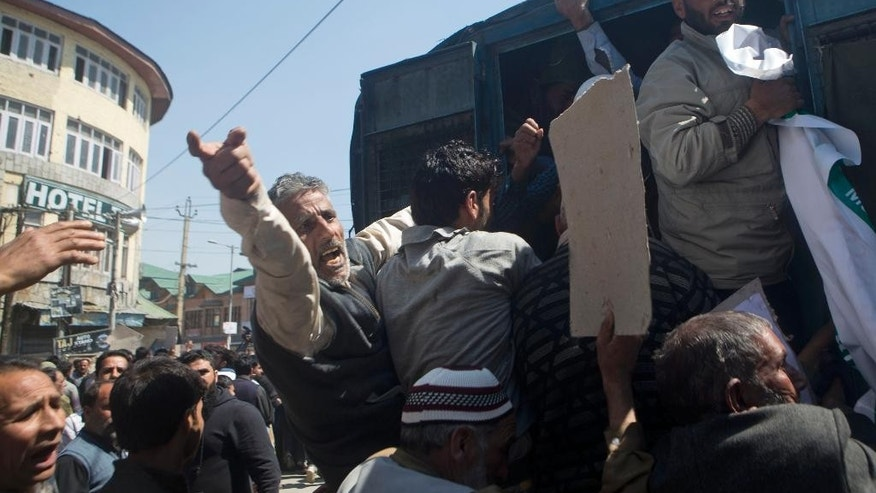 Supporters of Jammu and Kashmir Liberation Front (JKLF) shout slogans against India after they were detained during a protest march in Srinagar, Indian controlled Kashmir, Friday, April 10, 2015. Protests and clashes erupted Friday against government plan to build townships for displaced Kashmiri Hindus who fled the Muslim-majority areas of the disputed Himalayan region with the onset of armed rebellion against Indian rule. (AP Photo/Dar Yasin)