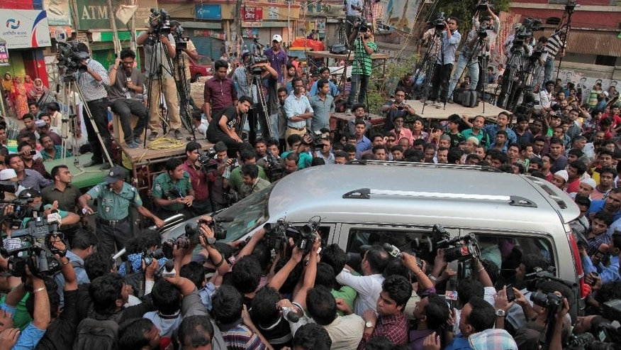 Journalists surround the car carrying family members of Mohammad Qamaruzzaman, an assistant secretary general of Jamaat-e-Islami party, as they leave the Central Jail after meeting Qamaruzzaman in Dhaka, Bangladesh, Saturday, April 11, 2015. Authorities have heightened security in Bangladesh's capital and elsewhere as the Islamist party official is expected to be executed late Saturday for his role in the mass killing of people during the nation's independence war against Pakistan in 1971. (AP Photo/A.M. Ahad)