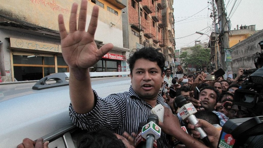 Hasan Iqbal speaks to the media after visiting his father Mohammad Qamaruzzaman, an assistant secretary general of Jamaat-e-Islami party, at the Central Jail in Dhaka, Bangladesh, Saturday, April 11, 2015. Authorities have heightened security in Bangladesh's capital and elsewhere as Qamaruzzaman is expected to be executed late Saturday for his role in the mass killing of people during the nation's independence war against Pakistan in 1971. (AP Photo/A.M. Ahad)
