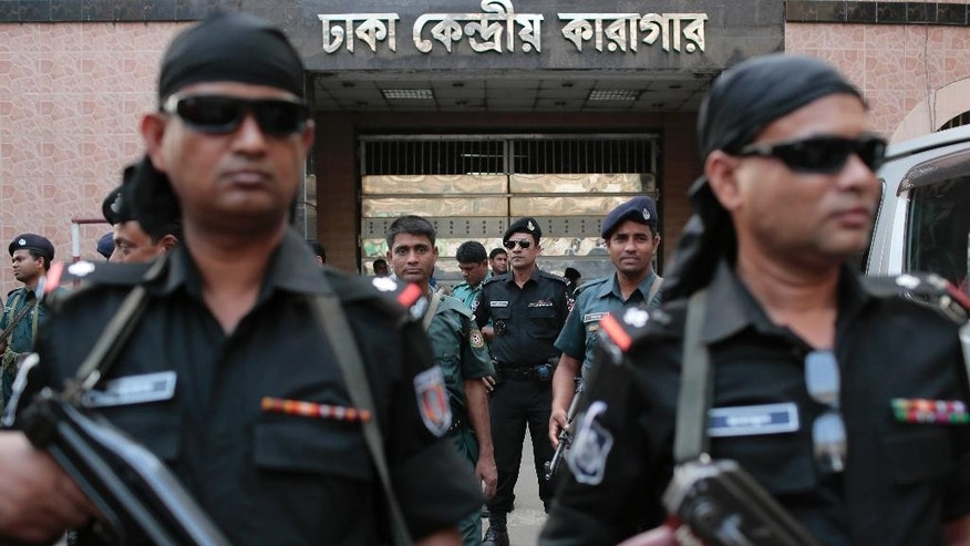 Bangladeshi security personnel stand guard outside Central Jail where Mohammad Qamaruzzaman, an assistant secretary general of Jamaat-e-Islami party, is being held, in Dhaka, Bangladesh, Saturday, April 11, 2015. Authorities have heightened security in Bangladesh's capital and elsewhere as the Islamist party official is expected to be executed late Saturday for his role in the mass killing of people during the nation's independence war against Pakistan in 1971. (AP Photo/A.M. Ahad)