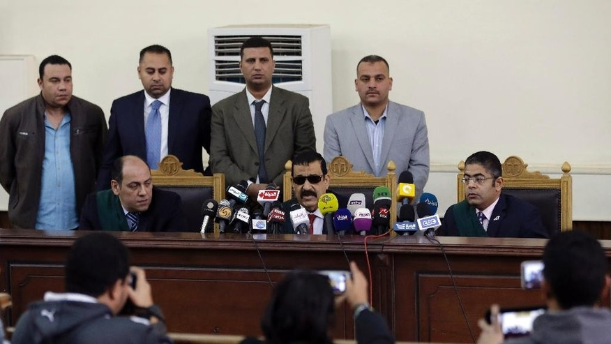 Egyptian Judge Mohammed Nagi Shehata reads the verdicts in a case rooted in violence that swept the country after the military-led ouster of Islamist President Mohammed Morsi in 2013, in Cairo, Egypt, Saturday, April 11, 2015. Egypt's official news agency said the court upheld death sentences for 14 people, including the leader of the country's banned Muslim Brotherhood, and sentenced 37 others to life in prison. US-Egyptian citizen Mohammed Soltan, who has been on hunger strike for more than 14 months as his health deteriorates, is one of the defendants handed a life sentence on Saturday on charges of financing an anti-government sit-in and spreading false news. (AP Photo/Hassan Ammar)