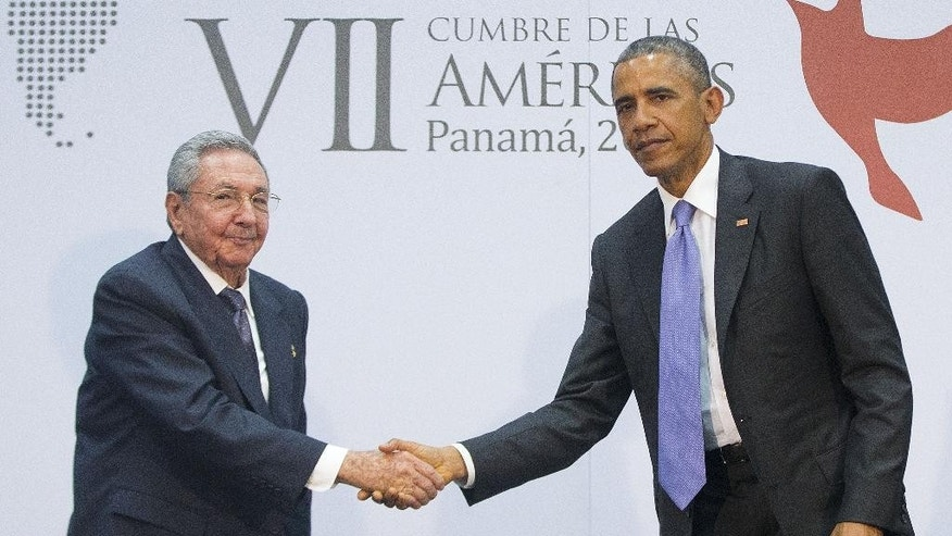 US President Barack Obama and Cuban President Raul Castro shake hands during their meeting at the Summit of the Americas in Panama City, Panama, Saturday, April 11, 2015. The leaders of the United States and Cuba held their first formal meeting in more than half a century on Saturday, clearing the way for a normalization of relations that had seemed unthinkable to both Cubans and Americans for generations.  (AP Photo/Pablo Martinez Monsivais)