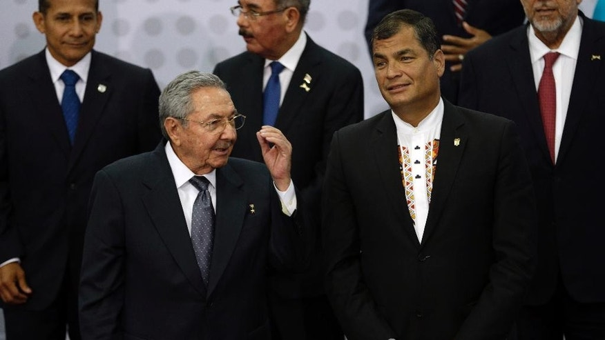Cuba's President Raul Castro, left, talks to Ecuador's President Rafael Correa, as leaders gather for the VII Summit of the Americas' official group photo, in Panama City, Panama, Saturday, April 11, 2015. (AP Photo/Arnulfo Franco)