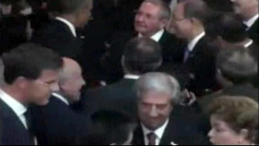 ADDS CASTRO - This image from Telesur video shows President Obama sharing a cordial evening handshake with Cuban President Raul Castro during a meeting on the sidelines of the Summit of the Americas Friday evening April 10, 2015 in Panama City, Panama. (AP Photo/TeleSUR)