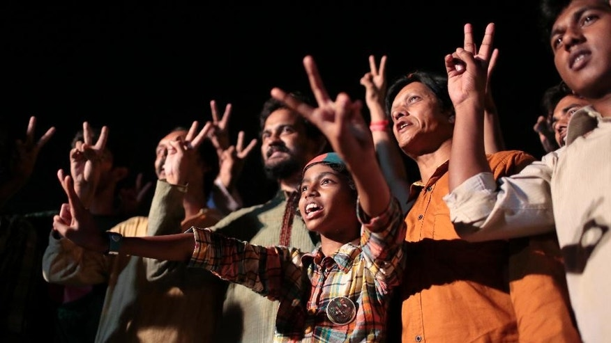 Bangladeshi activists, campaigning for capital punishment for war criminals, celebrate the execution of Mohammad Qamaruzzaman, an assistant secretary general of Jamaat-e-Islami party, in Dhaka, Bangladesh, Saturday, April 11, 2015. Authorities in Bangladesh on Saturday executed the senior Islamist party official convicted of crimes against humanity during the country's 1971 independence war against Pakistan, two officials and TV stations said. (AP Photo/A.M. Ahad)