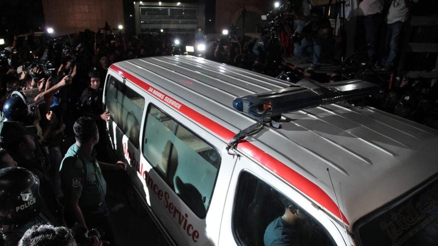 An ambulance leaves Central Jail carrying the body of Mohammad Qamaruzzaman, an assistant secretary general of Jamaat-e-Islami party, after he was executed in Dhaka, Bangladesh, Saturday, April 11, 2015. Authorities in Bangladesh on Saturday executed the senior Islamist party official convicted of crimes against humanity during the country's 1971 independence war against Pakistan, two officials and TV stations said. (AP Photo/ A.M. Ahad)