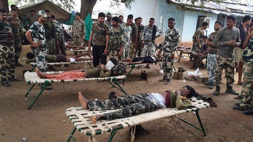 This Saturday, April 11, 2015 photo shows Indian policemen who were wounded in an attack by Maoist rebels being attended to by colleagues in Sukma district, 385 kilometers (240 miles) south of Raipur, India. The ambushed policemen were part of a special task force out searching for rebel activity early Saturday. (Press Trust of India via AP) INDIA OUT