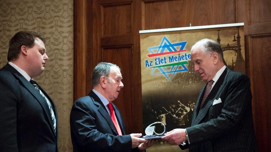 President of the World Jewish Congress Ronald S. Lauder, right, is awarded with the Kezdy Gyorgy Prize of the March of the Living by General Director of the March of the Living International Aharon Tamir, center, and Chairman of Board of the March of the Living Hungary Foundation Gabor Gordon, left, during a press conference held by the Federation of Jewish Religious Communities of Hungary (Mazsihisz) and the organizers of the March of the Living in Hotel Four Seasons in Budapest, Hungary, Sunday, April 12, 2015. (AP Photo/MTI, Balazs Mohai)