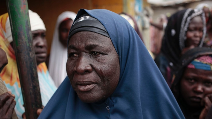 April 8, 2015 - A woman cries as she learns her relatives were killed by Boko Haram in Gwoza, Nigeria. An estimated 800,000 children have been forced from their homes by Boko Haram extremists, according to a UNICEF report. The number of refugee children has doubled in the past year in the Islamic uprising.