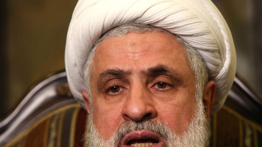 "The deputy chief of Hezbollah, Sheik Naim Kassem, speaks during an interview with the Associated Press, in the Shiite group's stronghold in southern suburb of Beirut, Lebanon, Monday, April 13, 2015. Kassem said Saudi Arabia made a ""strategic mistake"" by interfering in the internal affairs of Yemen suggesting that more than two weeks of Saudi-led airstrikes targeting Houthi rebels in that country have failed to produce results. He also said Saudi Arabia is committing ""genocide"" in Yemen and will pay a heavy price for its involvement. (AP Photo/Hussein Malla)"