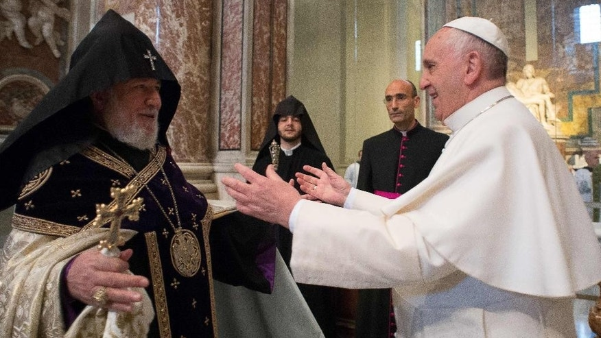 "In this Sunday, April 12, 2015 pool photo Pope Francis, right, is greeted by the head of Armenia's Orthodox Church Karekin II, left, during an Armenian-Rite Mass in St. Peter's Basilica, at the Vatican. Pope Francis on Sunday called the slaughter of Armenians by Ottoman Turks ""the first genocide of the 20th century"" and urged the international community to recognize it as such, sparking a diplomatic rift with Turkey. Turkey, which has long denied a genocide took place, immediately summoned the Vatican ambassador to complain and promised a fuller official response. (L'Osservatore Romano/Pool Photo via AP)"